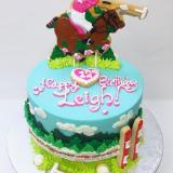 Polo player horse cake.