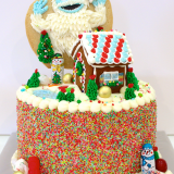 Holiday themed cake! Featuring Bumble and a gingerbread house topper!