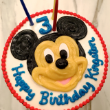 3D frosting sculpture of Mickey Mouse!