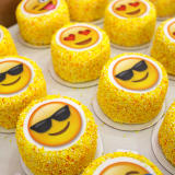 Custom ordered emoji themed mini cakes! We can add any image you'd like to our mini cakes. Wouldn't your bestie's face look so cute on one?!